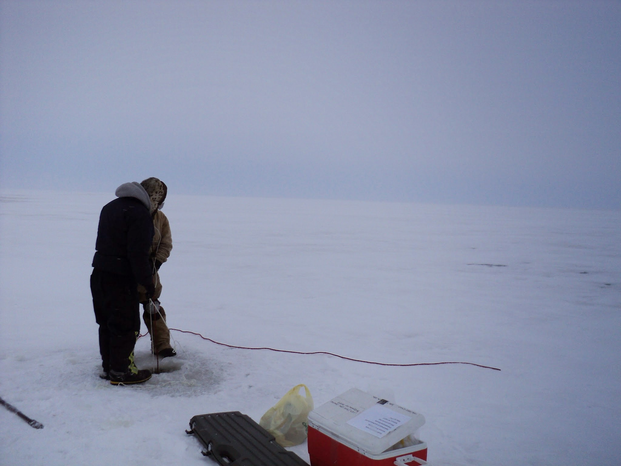 Taking a sediment core on a lake near Barrow, AK, October, 2010