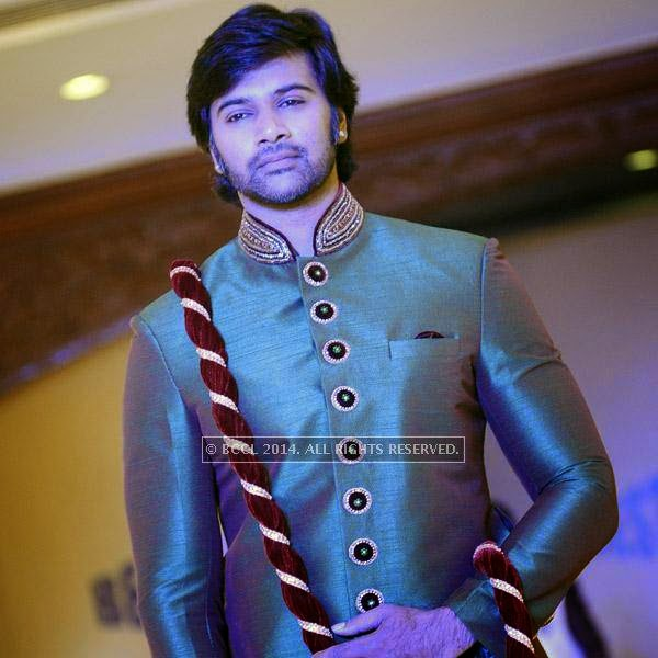 Abhishek showcases a creation during Year End Expo fashion show, held at hotel Breeze.