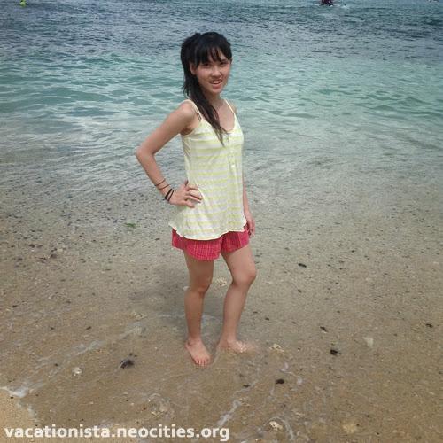 Gorgeous Alexia, stand in the white sand three