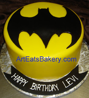 Custom yellow and black fondant kid's Batman symbol birthday design