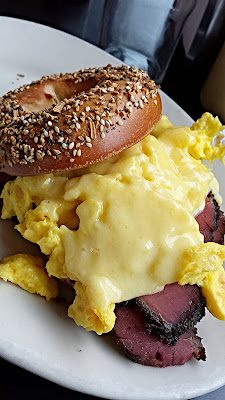 Kenny and Zuke Deli's delicious pastrami brunch with an Everything Bagel and Egg and Cheese (cheddar) with addition of Pastrami