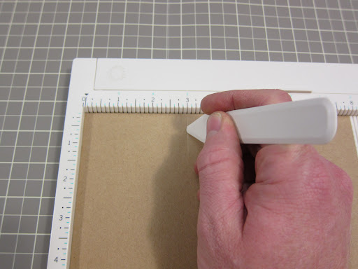 I scored each of the four edges of each piece of paper at the 2-inch mark and folded along the score.