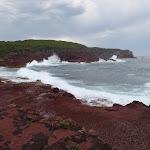 Waves crashing into red platform bay (104992)