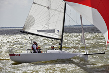 J/70 one-design sailboat- sailing fast on Galveston Bay, Houston, Tx