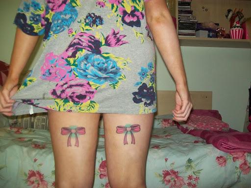 bow tattoos on legs