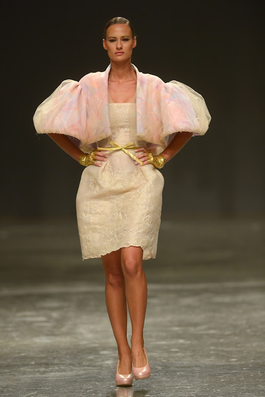 DUBAI, UNITED ARAB EMIRATES - APRIL 10:  A model walks the runway at the Ezra show during Dubai Fashion Forward April 2015 at Madinat Jumeirah on April 10, 2015 in Dubai, United Arab Emirates.  (Photo by Stuart C. Wilson/Getty Images for Fashion Forward)