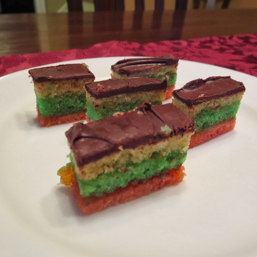 Rainbow Cookies are an almond-paste cookies with a chocolate glaze and moist interior.