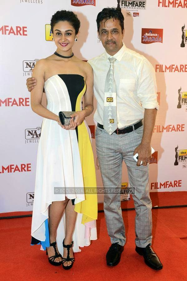 Actor Arjun arrives with his daughter Aishwarya for the 61st Idea Filmfare Awards South, held at Jawaharlal Nehru Stadium in Chennai, on July 12, 2014.