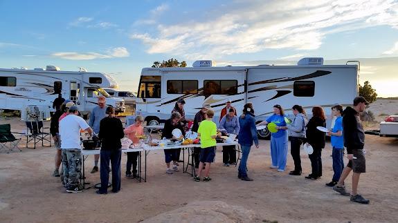 Potluck dinner at camp on Saturday