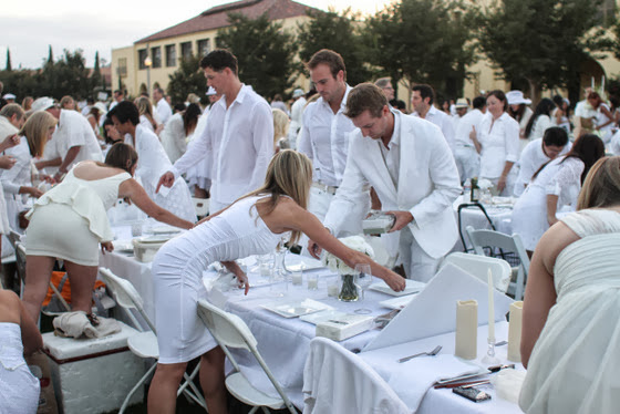 photo of guests setting their tables for Diner En Blanc