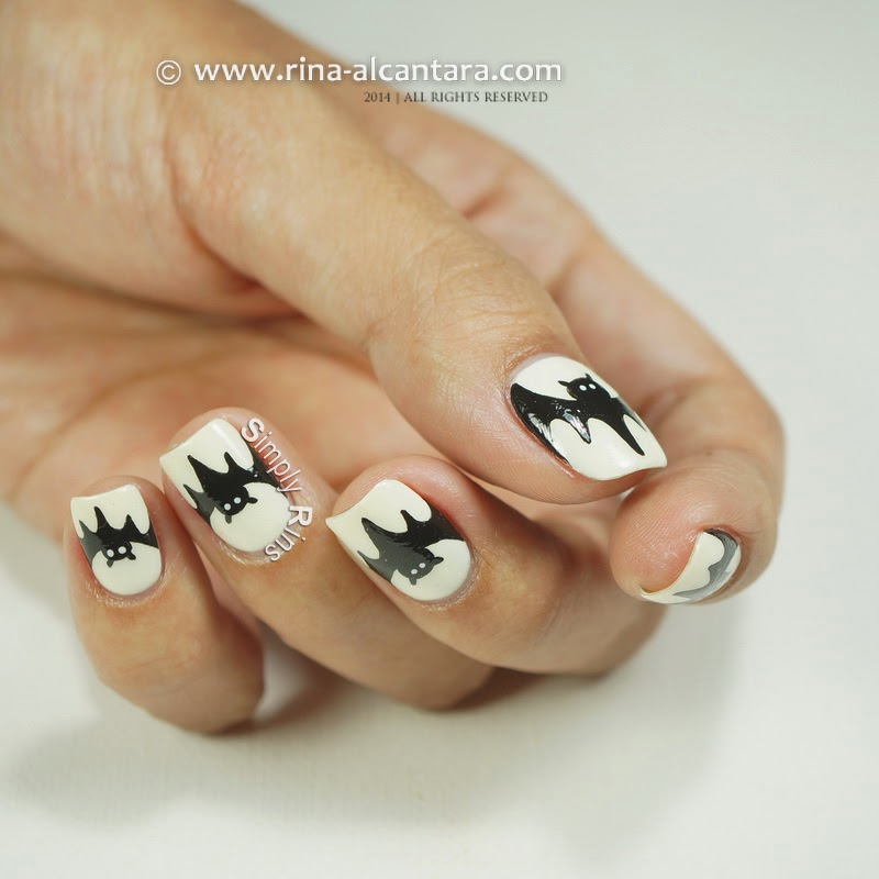 This freehand Halloween nail art was painted using black and white acrylic  paint and a detail nail art brush. It was easy to work with my dominant  hand but ... - Nail Art: Bats Simply Rins