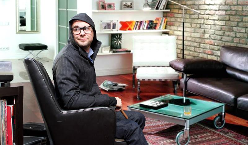 Exec Hoodie Sitting Smirking in Glasses