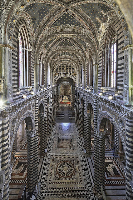 Siena cathedral: panoramic view of the nave and the uncovered marble floors
