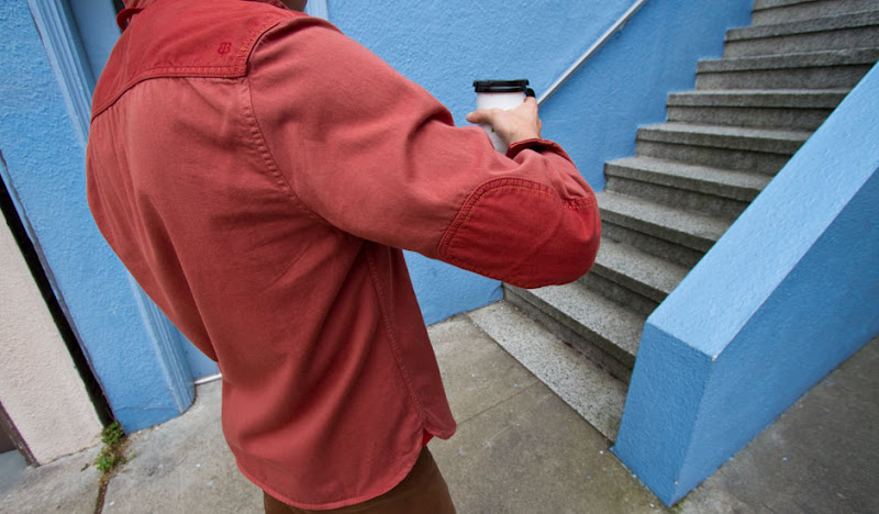 Betabrand Cherry Shirt Holding A Cup of Joe