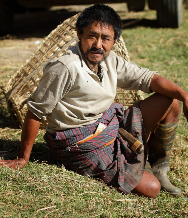 Traditional Trongsa Farmer soaking in the winter sun