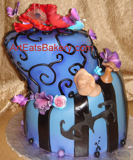 Tim Burton style topsy turvy blue, black and purple fondant custom birthday cake design with flowers, mushrooms, bat and butterflies