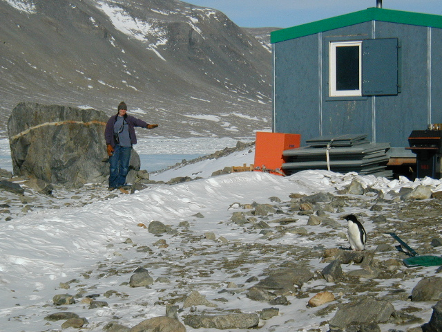 Rae (Hoare camp manager) and Adelie penguin