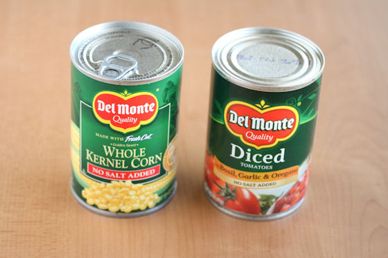 photo of a can of corn and a can of diced tomatoes