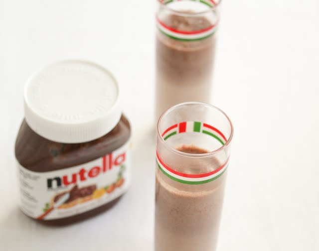 photo of a two nutella milkshakes in tall narrow glasses