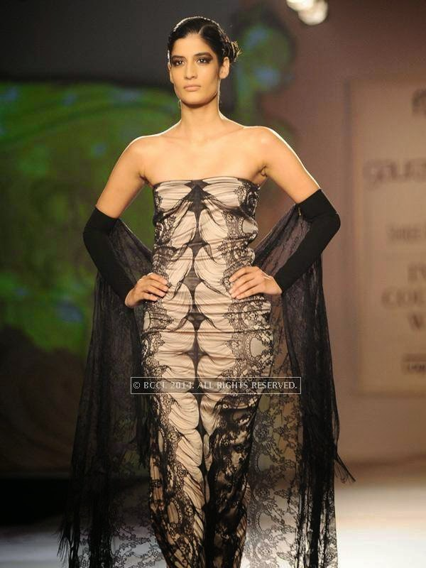 Erika showcases a creation by designer Gaurab Gupta on Day 3 of India Couture Week, 2014, held at Taj Palace hotel, New Delhi.