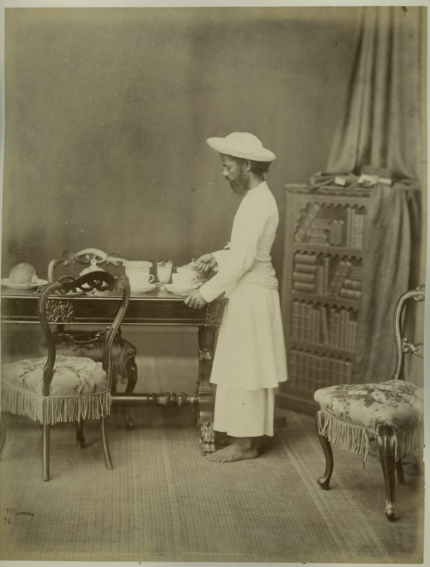 Indian Servant Arranging Tea Pots - Circa 1869