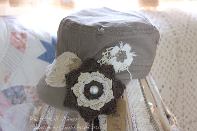 Womens cap with wing, cross and flower