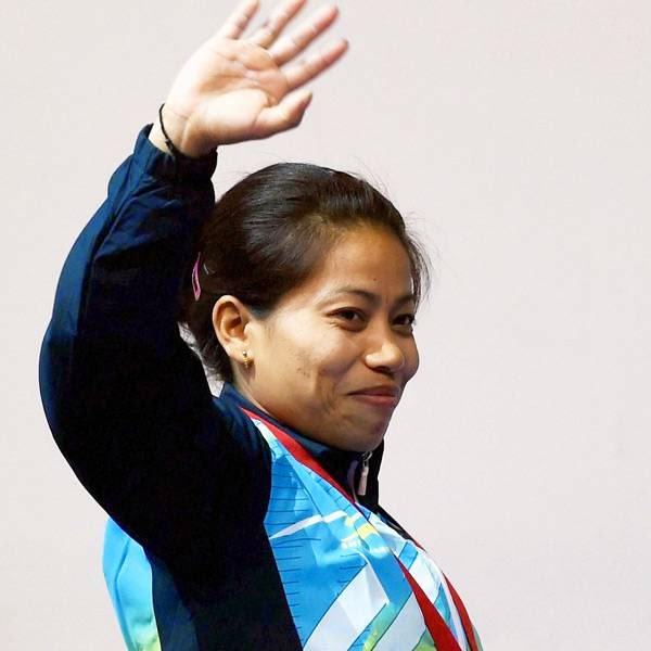 India's gold medalist Sanjita Khumukcham waves after the medal presentation ceremony of 48-kg women's weightlifting event at the Commonwealth Games in Glasgow, Scotland
