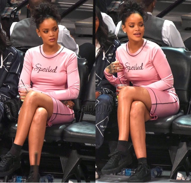 Rihanna attends the NBA All-Star game in Adam Selman