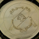 The presidential crest impressed on a gold plated plate.