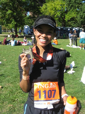 Michelle Judd of Taste As You Go and her Medal for Running the 2010 ING Hartford Marathon in Hartford, CT
