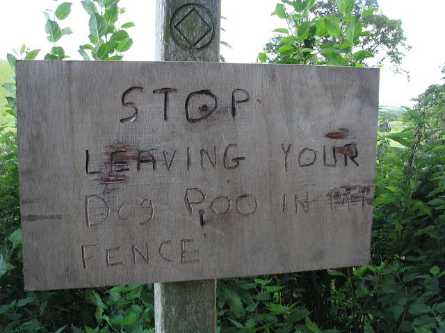 Stop leaving your dog poo in my fence