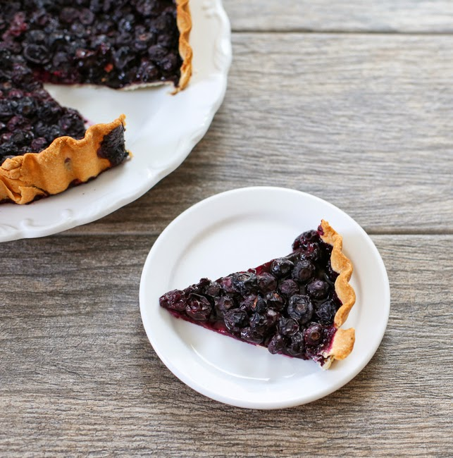 overhead photo of a slice of blueberry tart