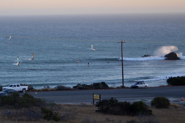 windsurfers and wave surfers