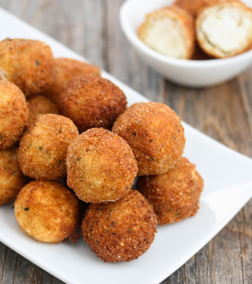photo of a pile of Fried Mashed Potato Balls on a white plate