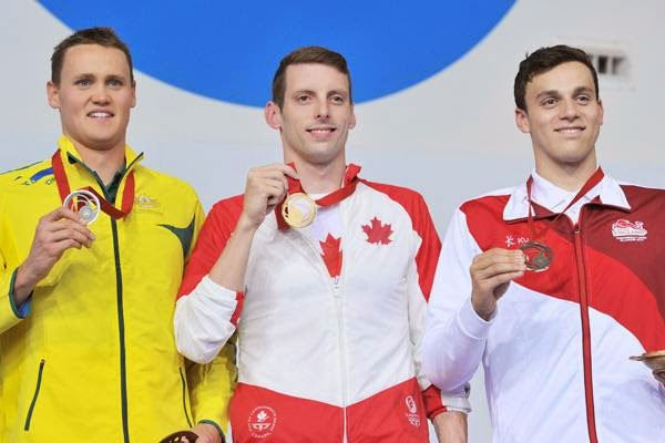 (L-R) Silver medallist Australia's David McKeon, Gold medallist Canada's Ryan Cochrane and Bronze England's Guy James pose on the podium during the Men's 400m freestyle medal ceremony at the Tollcross International Swimming Centre during the 2014 Commonwealth Games in Glasgow on July 24, 2014.