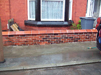 boundary wall rebuilt with traditional lime mortar