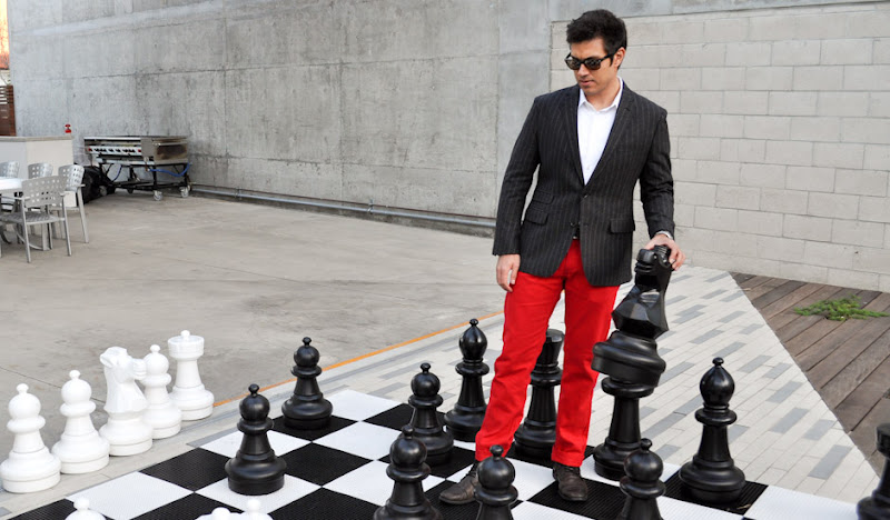 Justin Oliver plays chess in his #RedPantsFriday