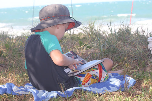 Nathan relaxing with a book