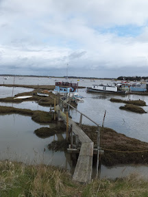 Precarious jetty out to the boats at Felixstowe Ferry