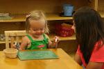 LePort School Parent/Child Montessori - mommy watching as her child writes