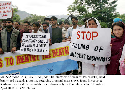 MUZZAFARABAD, PAKISTAN, APR 10: Members of Press for Peace (PFP) hold  banner and placards protesting regarding thousand mass graves found in occupied  Kashmir by a local human rights group during rally in Muzzafarabad on Thursday,  April 10, 2008. (PPI Photo).