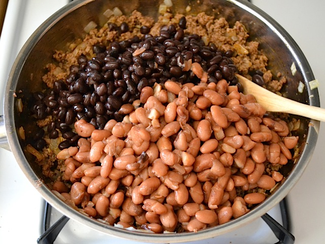 beans added to meat in pan