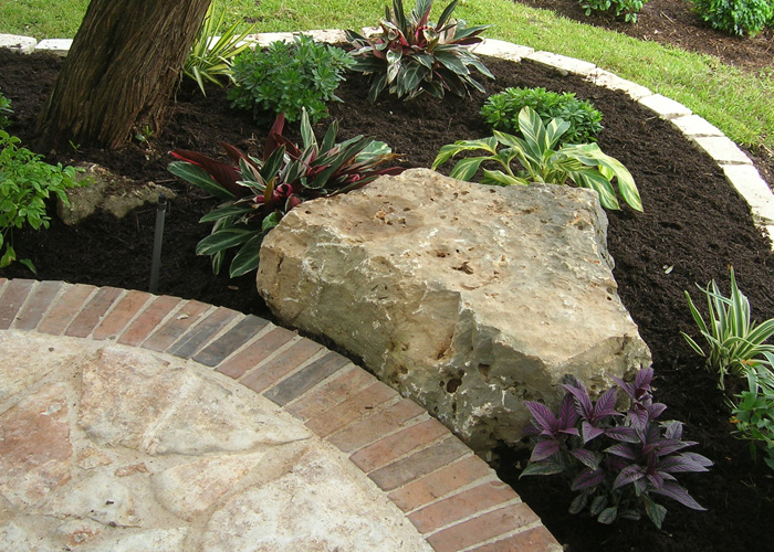 Austinmomof6 texas xeriscapes for Landscaping rocks austin