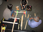 Teachers build ramps and roll objects down them.