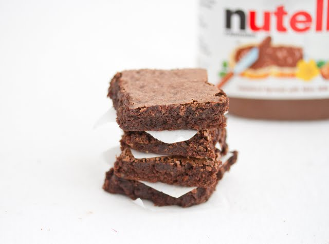 Flourless Nutella Brownies stacked on top of each other