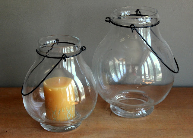 Bulbous glass pillar holders available for rent from www.momentarilyyours.com