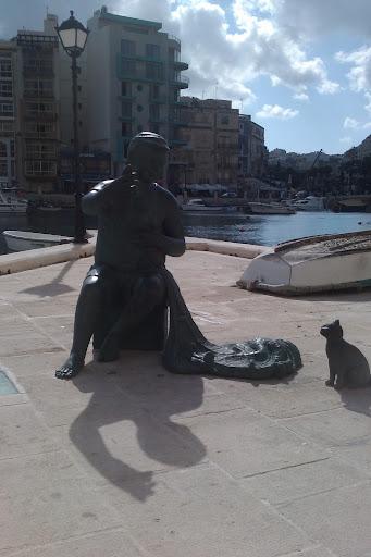 Mannen på bilden ser ut att vara fiskare. En bild från dagens promenad
