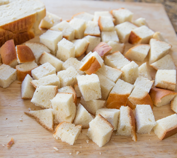 photo of a challah loaf cut into cubes