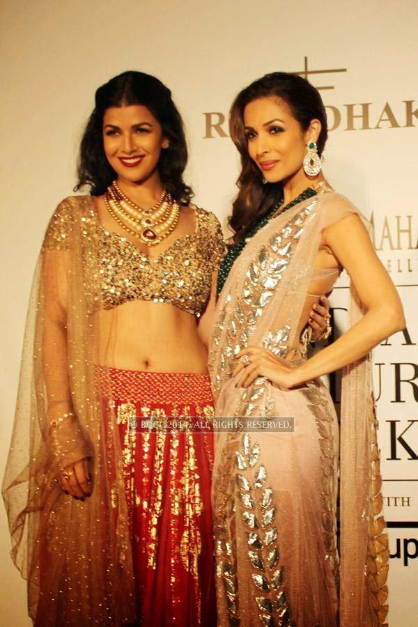 Nimrat Kaur and Malaika Arora Khan pose during the India Couture Week, 2014, held at Taj Palace, in New Delhi.