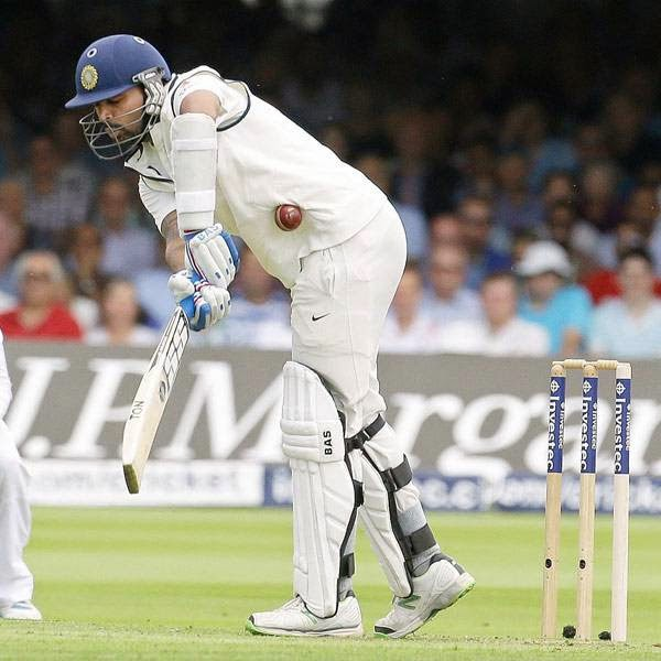 India's Murali Vijay plays a shot off the bowling of England 's James Anderson during the first day of the second test match between England and India at Lord's cricket ground in London, Thursday, July 17, 2014.